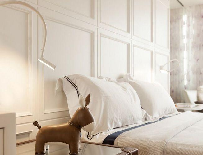 Molduras en la cabecera de la cama