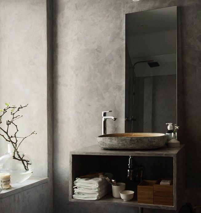 Piso y pared en cemento y detalles en madera